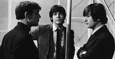 Neil Aspinall (left) talks to Beatles Paul McCartney and John Lennon. Photograph: Robert Whitaker/Hulton archive