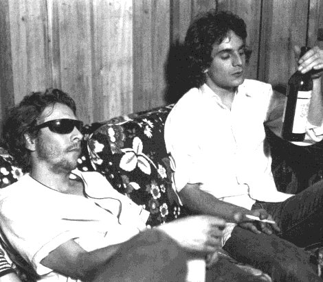 Dan Penn (in glasses) and Alex Chilton lounging at the Sam Phillips Recording Service, mid-1970s. Photo by William Eggleston.