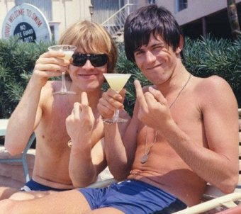 Brian Jones amd Keith Richards have a drink in the sun at the Jack Fort Harrison Hotel in Clearwater, Florida